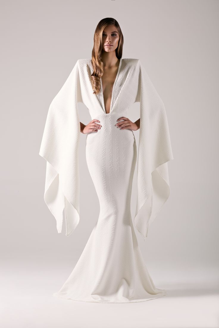 White kimono sleeve mermaid gown with plunge neckline & strong shoulders.- Michael Costello US Size Chart- Made true to size- When choosing height, include the inches of your heels- If you select custom, one of our representatives will contact you for size information- Dry clean only