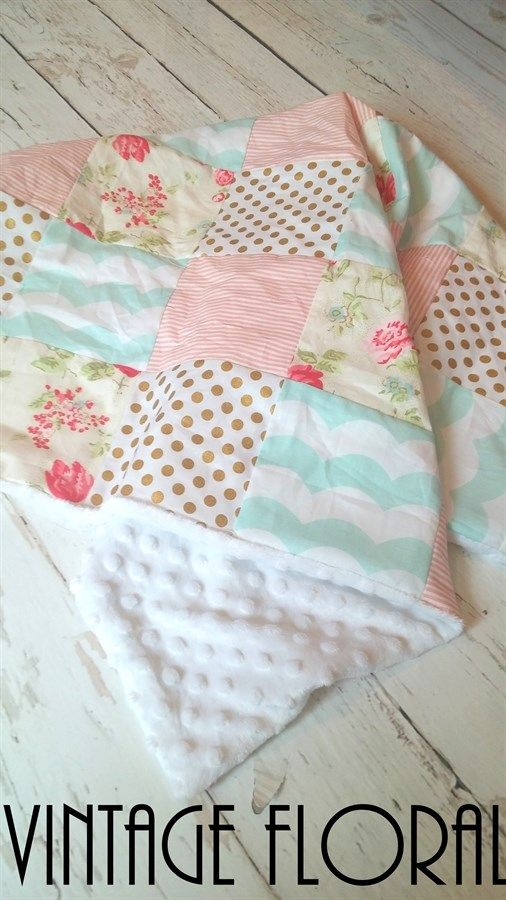 "This unique patchwork blanket is perfect for on the go, strollers/car seats, or simply for your little one to cozy up with.INCLUDES:1) On the Go Patchwork Baby Blanket   *Soft minky on back *Approx 34"" x 32"" (Placement of fabrics will  vary with each blanket)"