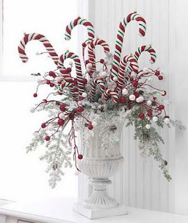 use candy canes in centerpiece. great idea for the kids table at Christmas dinner