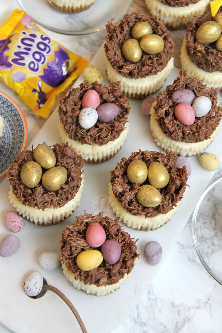 Individual Creamy Vanilla Cheesecakes topped with Easter Nests, and Mini Chocolate Eggs. Perfect Mini Easter Nest Cheesecakes for Easter! I wanted to make something slightly...