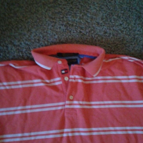 Tommy Hilfiger polo tee shirt Salmon or pink (whatever you prefer) and white striped polo tee shirt. Very nice, bright color. Size M says tag but probably a L for women. Tommy Hilfiger Shirts Tees - Short Sleeve
