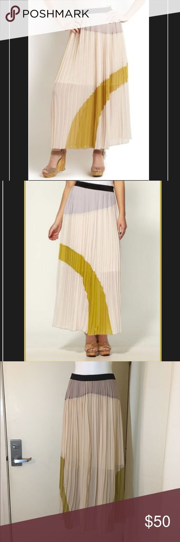 ARYN K LONG PLEATED CHIFFON MAXI SKIRT This ARYN K LONG PLEATED CHIFFON MAXI SKIRT is in new condition. Only used once. Flirty and fun, Aryn K skirts are just the right amount of elegant and playful. These skirts are flattering stylish & effortlessly chic whether styled up or down. This scene-stealing style features precision pleating on a sweeping, maxi silhouette. Polyester; lining: polyester/elastane Designed for a contemporary fit Banded waist, allover landscape print and pleating Ankle…