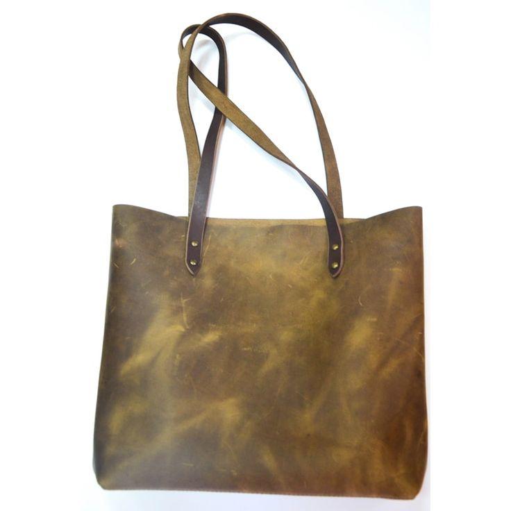 Оригинальная женская сумка - шоппер ручной работы из высококачественной итальянской лицевой кожи, роскошный подарок для практичной женщины. Кожа глубокого цвета хаки, обработана и окрашена экологически чистыми материалами, прошита вручную. На коже может быть еле заметные естественные пороки –