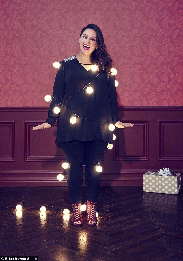 She's a looker:Melissa McCarthy, 45, shows off her ever-slimmer frame in the advertising campaign forher Seven 7 Holiday 2015 clothing line