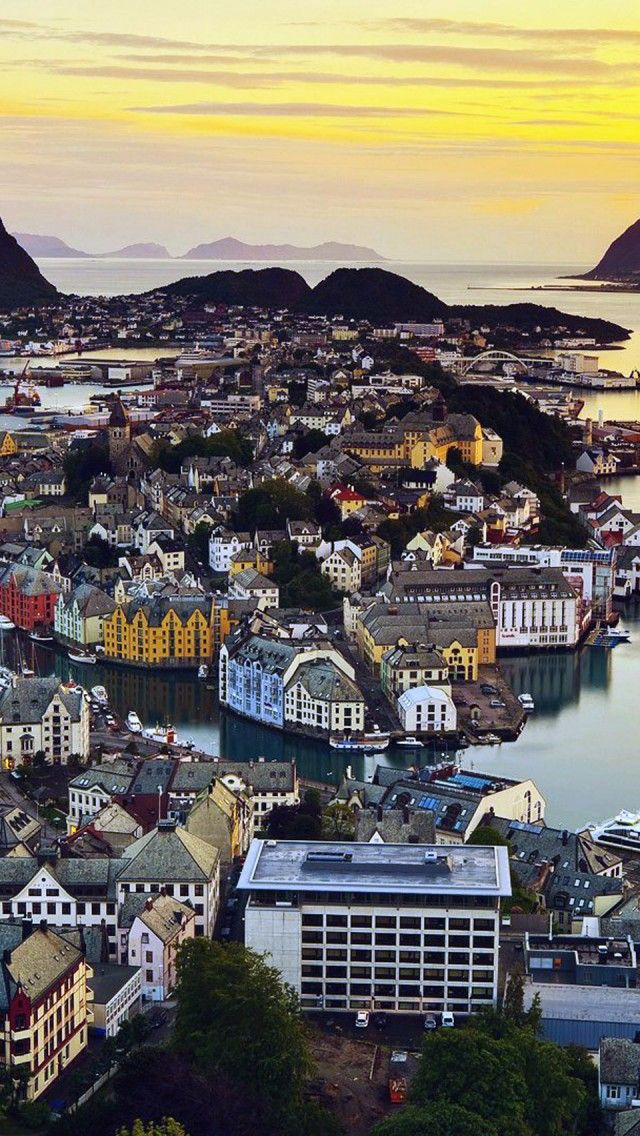 Alesund, Norway. The city of Ålesund is known for its architecture in Art Nouveau style, its surrounding fjords and the high peaks of the Sunnmøre Alps. (V)