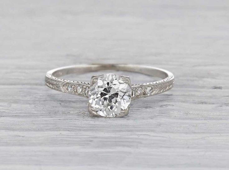 Antique Art Deco engagement ring made in platinum and centered with a GIA certified .91 carat old European cut diamond with I color and VS2 clarity. Signed Tiffany & Co. Circa 1925.