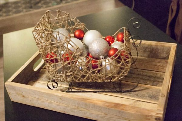 Red Coffee Table Centerpiece : Pair a rustic sleigh with red and silver ornaments to