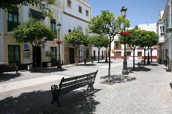 """Rota Spain  The downtown shops and orange trees on the """"walking street"""""""