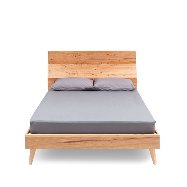 SHANNON BED    Shannon can be ordered to fit any standard size mattress, the Queen size bed photographed here is in Feature grade Oak. This design's shaped bedhead is achieved using both solid and veneered timbers.  Australian made with a Lifetime Guarantee.