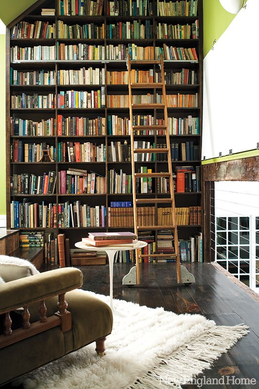 Architect Kraig Kalashian transformed a worn and dusty hayloft into a book-lover's sanctuary. Photo by John G. Bessler