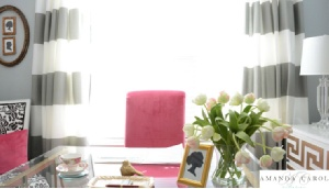 Amanda Carol Interiors    Amazing pink & gray office design with gray walls paint color, white & gray curtains window panels, hot pink chair, Ikea Malm 6 Drawer Fresser with gold Greek key overlays from My Overlays, silhouette prints and crystal urn lamps.
