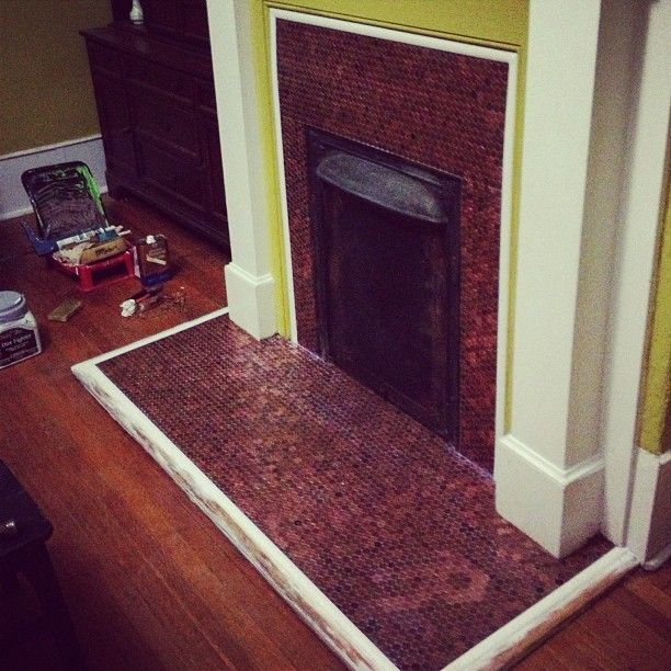 Penny tiled fireplace... WOAH!! Want to make a Penny floor, Penny fireplace, penny backsplash, penny bar? Lots of penny project submissions already featured in this gallery. Great inspiration!