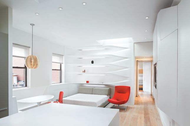 Continuous corian built-ins - floated off the ground - with multiple programs inside.