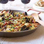 Traditional Spanish Paella Recipe | MyRecipes.com -- This is an ambitious recipe since I've never made Spanish food in my life (other than Guac), but it looks really good so I'd like to try it sometime.  (Also) Uncle got me a pack of saffron from Tibet and it seems the most iconic dish that features that spice is paella... so why not?