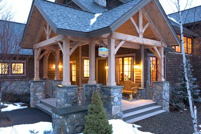 Timber frame entry - porch light; stairs; post/beam; gables