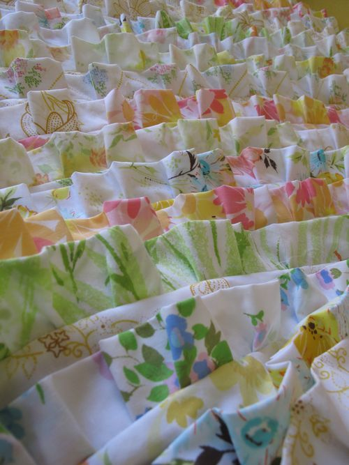 Vintage sheets made into a ruffled bedspread.  How clever!