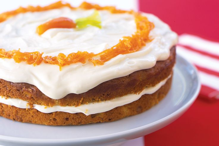 Carrot cake is elevated to centrepiece status with this beautifully decorated version which has cream cheese frosting, carrot syrup and candied carrots on top.