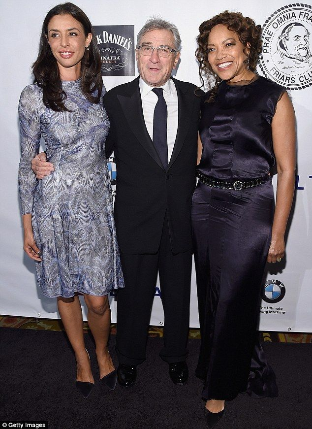 A lovely pair: Robert De Niro (center), looked proud as he showed off daughter Drena (left), and wife Grace Hightower (right) at a New York charity gala on Tuesday