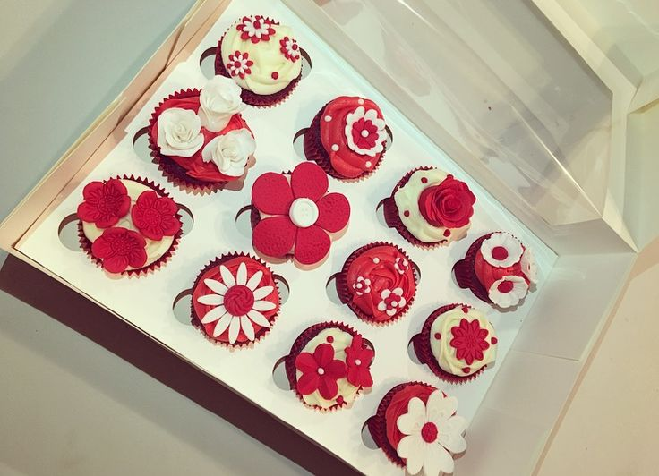 Red and white flower cupcakes! So pretty and elegant!  Check out my page https://www.facebook.com/frosted.cupcakes.invercargill/