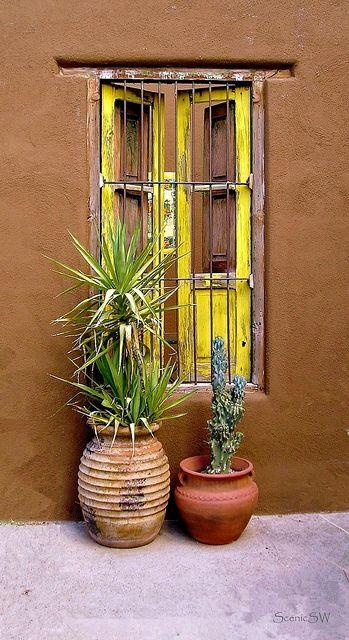 Yellow window on an adobe house in Tucson, Arizona.