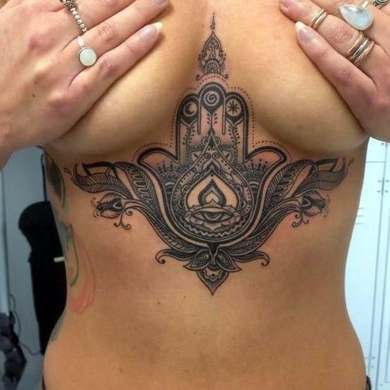 This hamsa sternum tattoo is bold a beautiful!