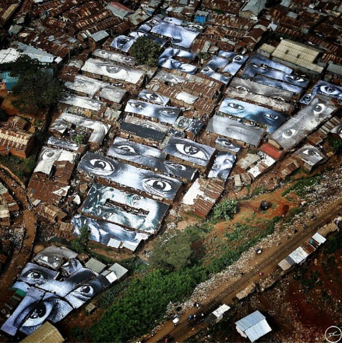 JR blows my mind.  4000 sq meters of images of the faces of women printed on vinyl to protect the rooftops in Kibera against rain.