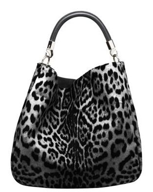 So me.  Everything I wear is pretty much black, grey and white.  Just love this bag.
