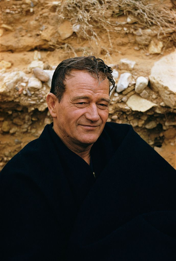 John Wayne  - I idolized him when I  was little because he looks so much like my Dad.