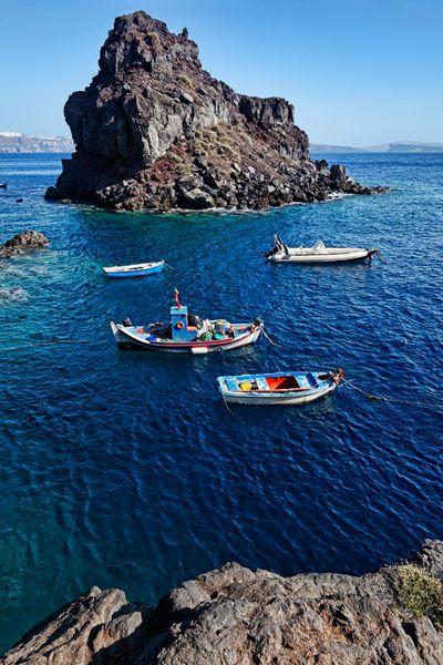 A rock near Ammoudi bay in Santorini , Greece