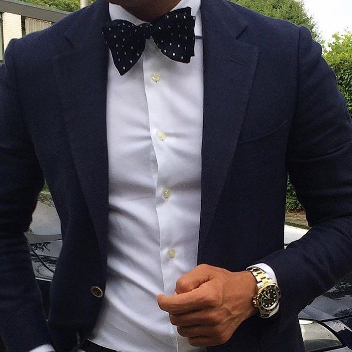 Navy and white polka dot bow tie