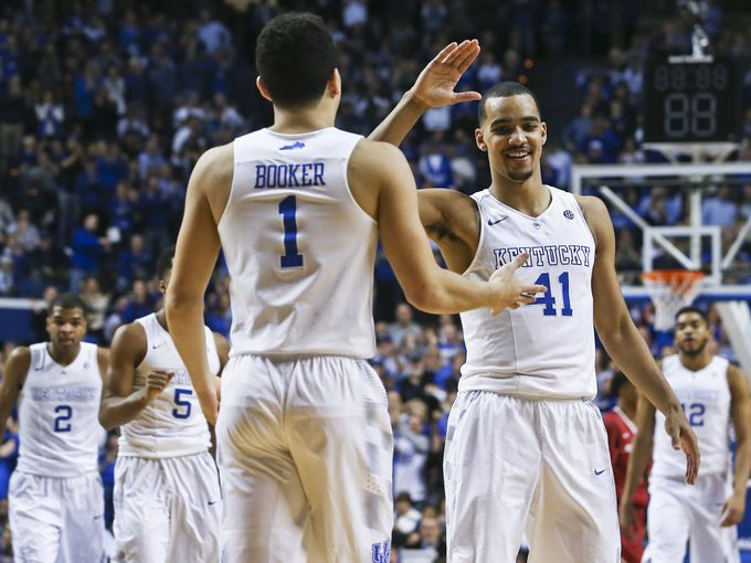 Kentucky's Devin Booker and Trey Lyles congratulates each other in win over Arkansas. 2-28-15 Cats win it 84-67.