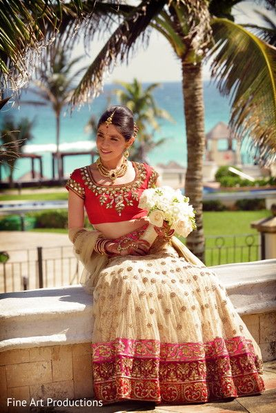 This Indian bride is beautiful in a red and gold lengha.