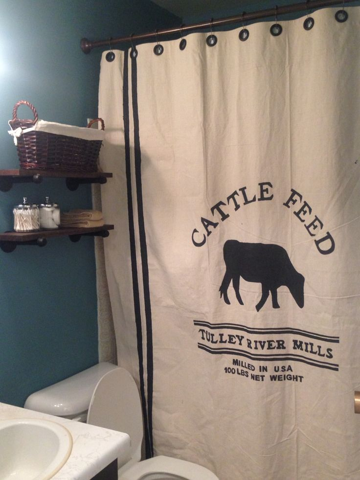 DIY grain sack shower curtain and rustic/industrial shelves!