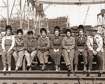 Line of women welders who worked in factories during World War II. They were referred to as Rosie-the-Riveter. 1942