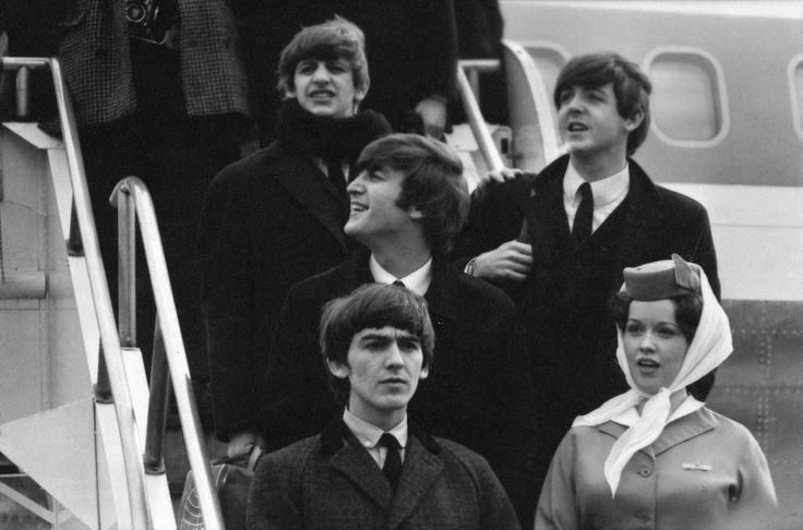 NEW YORK - FEBRUARY 7: The Beatles arrive at John F. Kennedy International Airport, February 7, 1964.  At top is Ringo Starr, middle row is John Lennon and Paul McCartney, lower level is George Harrison and unidentified flight attendant. (Photo by CBS via Getty Images)  via @AOL_Lifestyle Read more: http://www.aol.com/article/2016/10/17/phil-collins-reveals-14-year-feud-with-paul-mccartney-following/21585501/?a_dgi=aolshare_pinterest#fullscreen