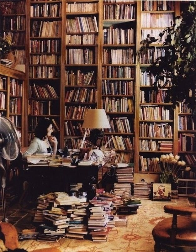 Nigella Lawson, likes having all her favorite books within arm's reach -- Check out the workspaces of these 9 famous #writers and artists, then share your favorite space using the hashtag, ‪#‎writespace‬