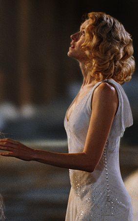 White dress, drapey back, knee length like the hair style ... Renee Zellweger