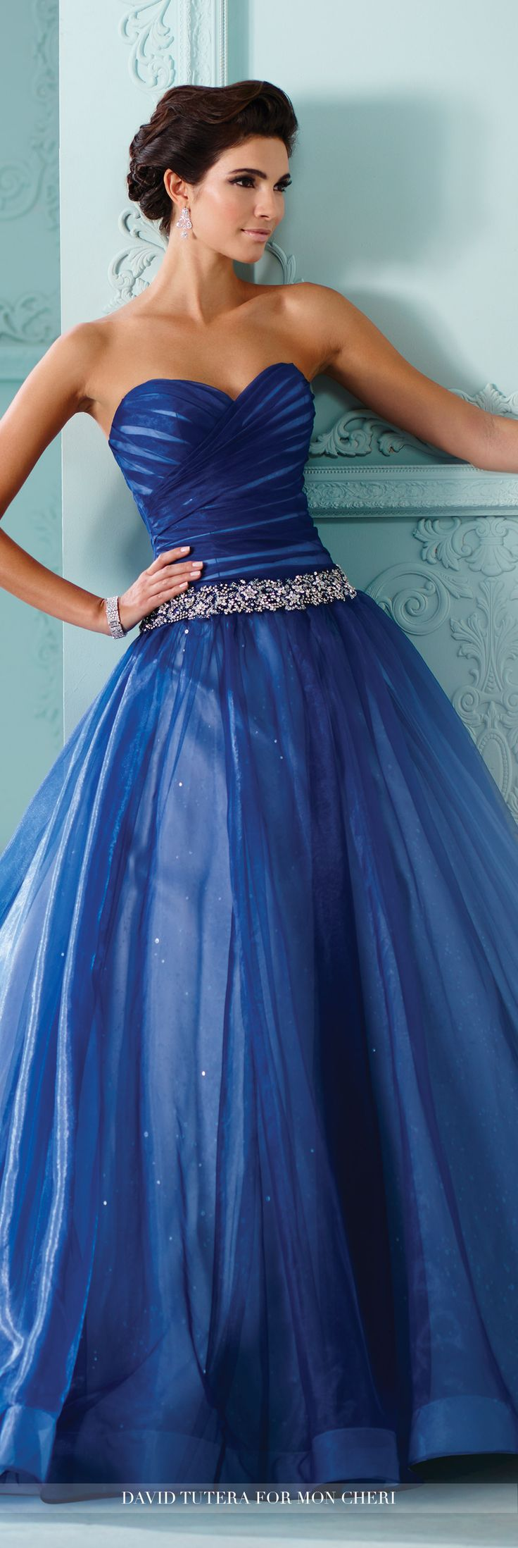 David Tutera for Mon Cheri - 216257 Indigo - Strapless organza over sequined tulle and satin ball gown with sweetheart neckline, directionally ruched bodice with attached jewel encrusted belt at dropped waist, full gathered skirt, horsehair hem, cathedral length train, detachable spaghetti and halter straps included.  Sizes: 0-20, 18W-26W  Tea Rose, Sapphire, Ivory