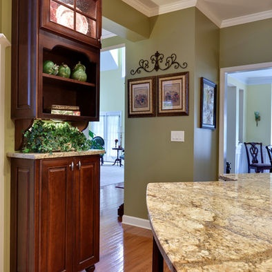 Golden oak wood floor with sage green walls. I also like the crown molding. Maybe use this in the kitchen