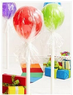 balloons wrapped in clear wrapping paper for candy land party decor