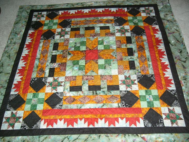 My version of AQS Mystery quilt.  Named it Fire on the Mountains in memory of Hayman Fire.  Then Came Waldo Canyon fire.