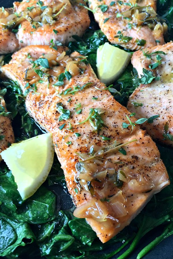 Pan-Roasted Salmon with Thyme Butter Sauce - the thyme sauce that is drizzled over the salmon literally dances in your mouth! Serve this dish on a bed of sauteed spinach for a lovely pairing.