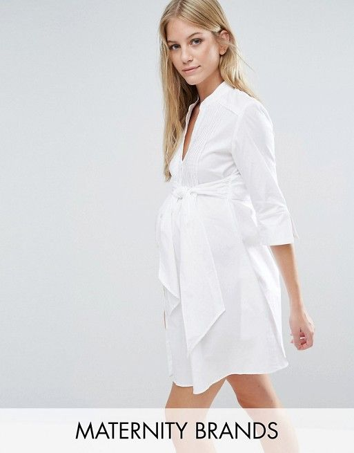 Isabella Oliver Longline Shirt Dress With Tie Waist  Crisp stretch cotton  Collarless style  Pintuck pleat panel  Button placket  Tie waist detail  Longline cut to cover your growing bump  Regular fit - true to size  Designed to fit through all stages of pregnancy  Machine wash  97% Cotton, 3% Elastane