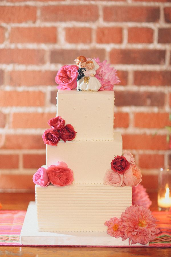 wedding cake with pink flowers - photo by Lukas and Suzy VanDyke http://ruffledblog.com/colorful-carondelet-house-wedding