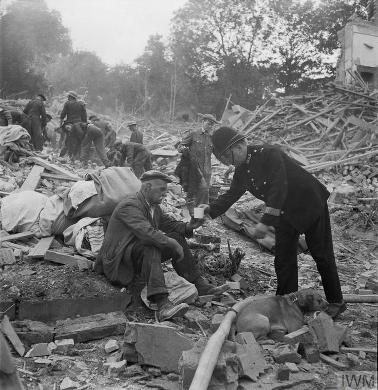 PC Frederick Godwin offers tea and sympathy to a now homeless man who returned home from walking his dog to find his house destroyed and wife killed by a V1 flying bomb. London 1944 [774x800] http://ift.tt/2g44JkM