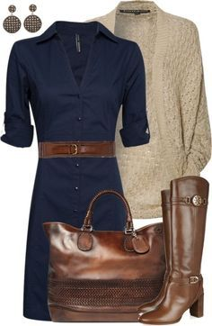 Pretty but looks restricting. Belted fitted knee length navy dress with brown and beige accessories