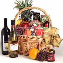 Table Wine, Cookies, Chinese Tea, Swiss Chocolates Gift Box, Assorted Biscuits and Tropical Dried Fruits in a picnic basket.