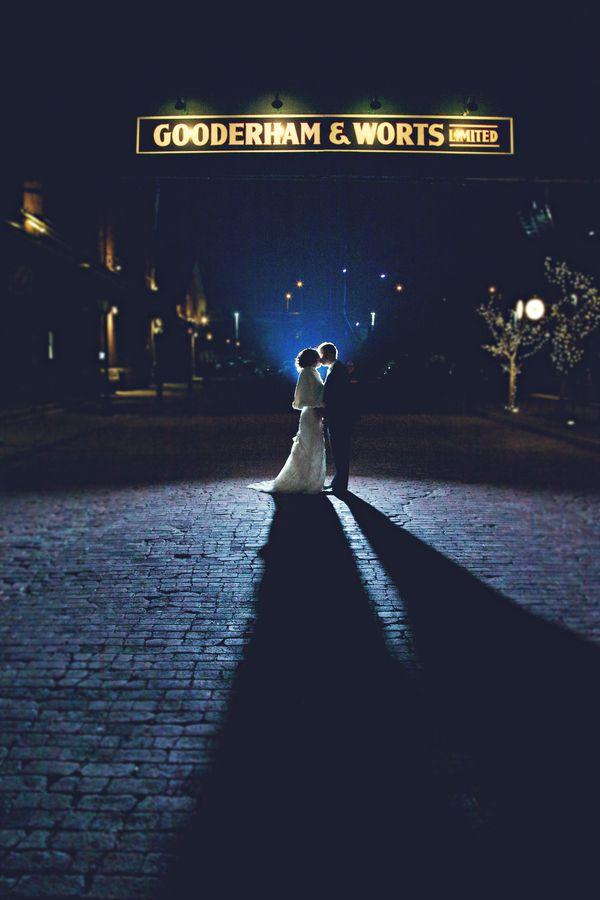 Night time bride and groom portrait taken in Toronto's Distillery District