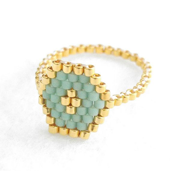 Definitely an all-time favorites. In velvety mint and 24k gold ring that has an instant romantic and luxe feel with detail work of a focal gold centre.  © Handmade by yours truly, JeannieRichard - - - - - - - - - - - - - - - - - - - - - - - - - - - - - - - - - - - - - - - - - - - - - RING SIZES in US CHART If you need a ring conversion guide, visit here: http://www.onlineconversion.com/ring_size.htm If your ring sizes falls between two sizes, order the larger size…