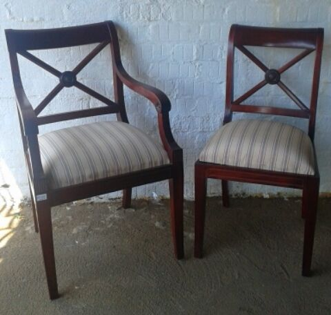 SOLD! #NorthcliffAntiques Regency style chairs. Wood: Red mahogany veneer. Finish: French polish. Details: Regency style chairs with sabre legs and drop in upholstered seats. Part of a set of eight, with two armchairs. Back: Sheraton square. #Chairs #Regency #RedMahogany #Antiques #Furniture
